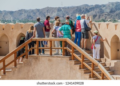 NIZWA, OMAN - MARCH 3, 2017: Tourists visiting the tower of Nizwa Fort, Oman