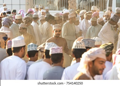 Nizwa, Oman - Nov 10, 2017: Omani men participating in a goat auction on Nizwa market.