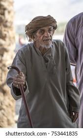 Nizwa, Oman, November 10th, 2017: old omani man on a Friday goat market