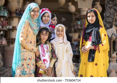 Nizwa, Oman, November 10th, 2017: omani girls, dressed in traditional clothing in celebration of Omani national day