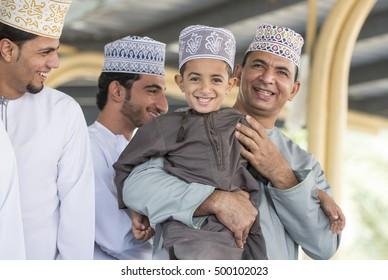 Nizwa, Oman, October 13th, 2016: father and son at Nizwa market