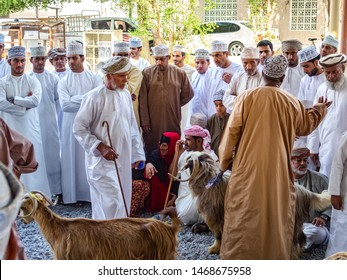Nizwa, Oman-August 05, 2016: Goatmarket in  Nizwa Oman with Omani people in there traditional clothes