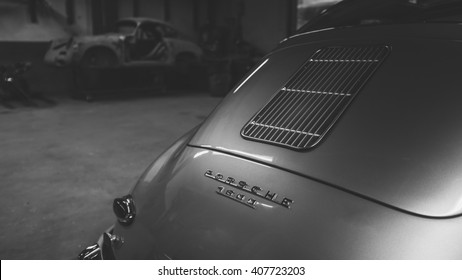 NJ - May 2015: A fully restored historic Porsche in the foreground while a stripped one is ready to begin in the background