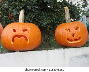 NJ, USA - October 1, 2016: Hand-carved Jack O'Lanterns sitting on a wall.