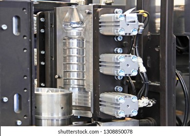 njection mold for PET bottles. The main working part of the machine blowing plastic bottles. Polished shiny surface.