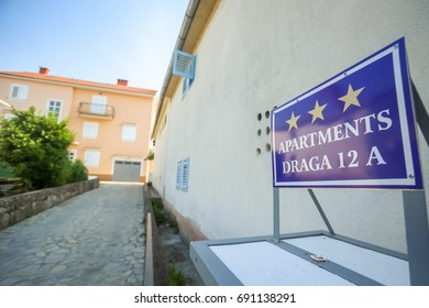 NJIVICE, CROATIA - JUNE 24, 2017 : Apartment rental sign in front of house in Njivice, Krk, Croatia.