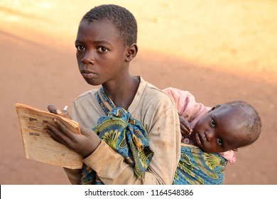 NKHOTAKOTA, MALAWI - JULY 1, 2018: Unidentified student in front of a small primary school in Nkhotakota. Malawi is one of the poorest countries in the world.