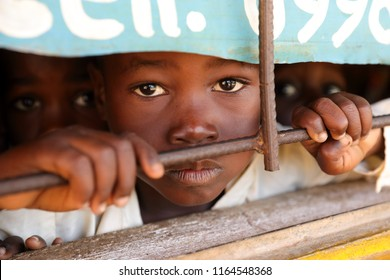 NKHOTAKOTA, MALAWI - JUNE 20, 2018: Unidentified student at the window of a small primary school in Nkhotakota. Malawi is one of the poorest countries in the world.