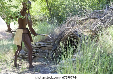 Nk'Mip Desert Cultural Centre, Osoyoos,British Columbia,Canada June 22,2017:Display of a sweat lodge and and attendant keeping it operating.
