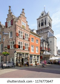 NLD, Delft, Zuid Holland -  JUN 7, 2018 - Historical buildings at Cameretten / Market, in the backgroud the tower of the Townhall