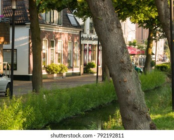 NLD, UTRECT - CIRCA JUN 2005 - Street view and ditch in the village Nijkerk in Holland