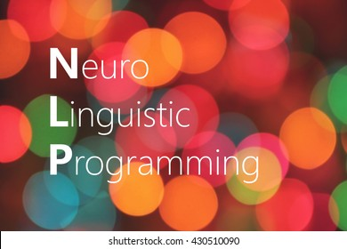 NLP (Neuro Linguistic Programming) acronym on colorful bokeh background