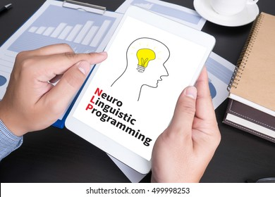 NLP   Neuro Linguistic Programming Modern people doing business, graphs and charts being demonstrated on the screen of a touch-pad,blank screen copy space