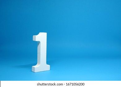 No. 1 ( One ) Isolated Blue  Background with Copy Space - Number 1 Percentage or Promotion success and the best winner Concept - First onject - Shutterstock ID 1671056200