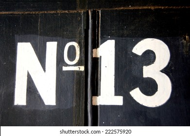 No. 13 in white on a black background