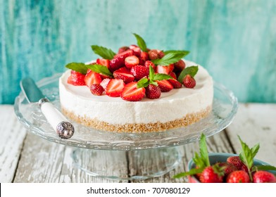 No Bake Strawberry Cheesecake Decorated with Fresh Berries and Mint, square