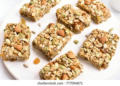 No baked granola bar on wooden board. Healthy natural snack