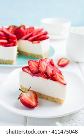 no baked strawberry cheesecake on white background, selective focus