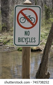 No Bicycles sign by creek