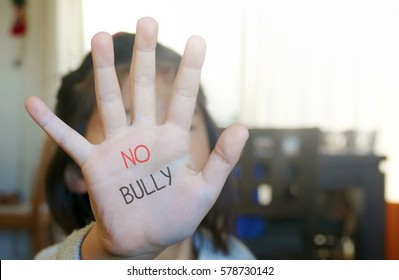no bully  text wrote on kid hand