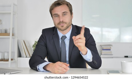No, Businessman Rejecting Offer by Waving Finger