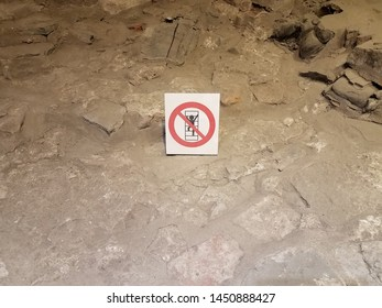 no climbing sign on soil and stone in cave