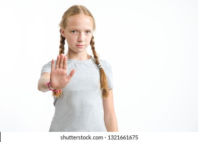 No, disagreement. A girl of 13 years old stretched out her hand forward as a sign of refusal. Portrait of a girl.