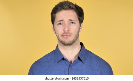 No, Disliking Casual Young Man on Yellow Background