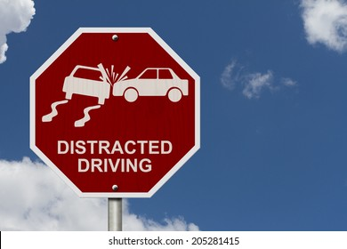 No Distracted Driving Sign, Red stop sign with words Distracted Driving and accident icon with sky background