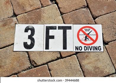no diving shallow water warning