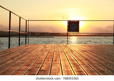 no diving sing on a wooden pier at sunset