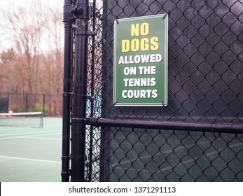 no dogs allowed sign on publice tennis courts