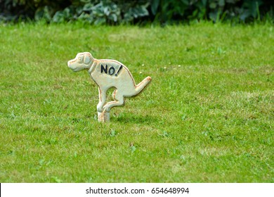No dogs poop zone sign.
