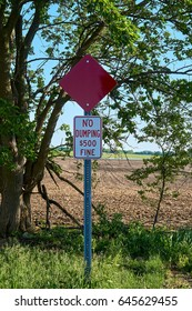 No dumping sign with fine in field
