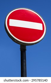 A No Entry sign with a clear blue sky behind it.