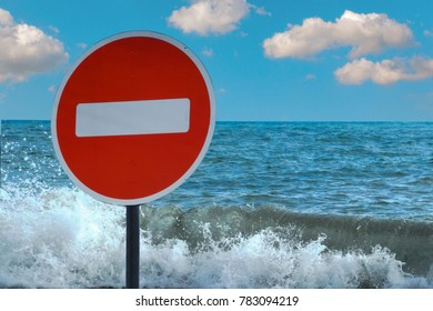 A no entry sign forbidden on the background of the sea or lake. Prohibited access to the shore. no swimming. Denied access to water.