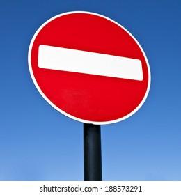 NO ENTRY Sign over a blue sky.
