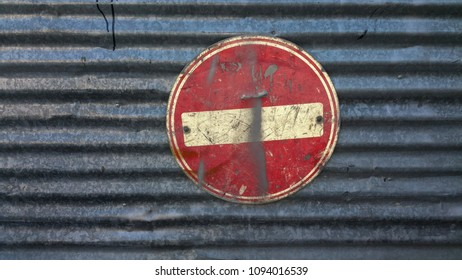 No entry traffic sign on metal board dirty and scratched – grunge style