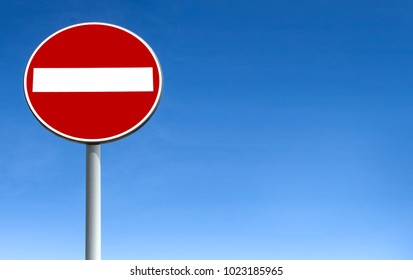 No entry for vehicular traffic. Road sign against blue sky. Space for text.