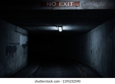 No exit sign. Dark tunnel