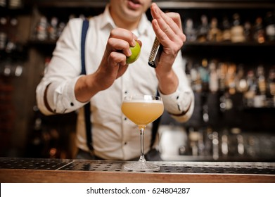 no face close up bartender is making a coctail with lime