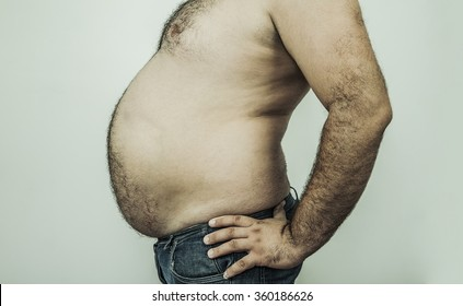 no face. unrecognizable person. Big stomach on a fat man isolated over white or gray background
