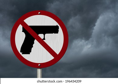 No Firearms Allowed Sign, An red road sign with handgun icon and not symbol with stormy sky background