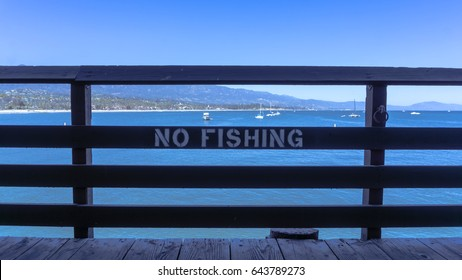 No fishing sign with a background view of the Santa Barbara coastline.