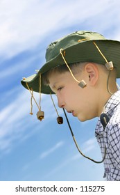 No flies on me mate! Outback aussie boy against vivid sky