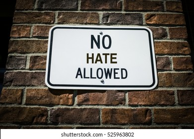 No Hate Allowed Sign on a Brick Wall