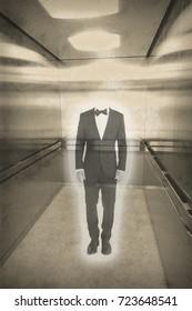 no head tuxedo man ghost in elevator