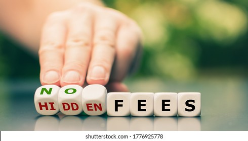 """No hidden fees concept. Hand turns dice and changes the expression """"hidden fees"""" to """"no fees""""."""