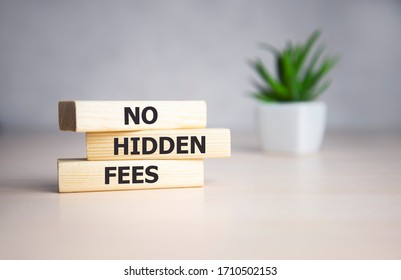 No hidden fees word written on wood block. No hidden fees text on wooden table for your desing, Top view concept.