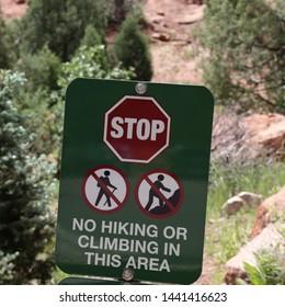 NO HIKING OR CLIMBING SIGNS